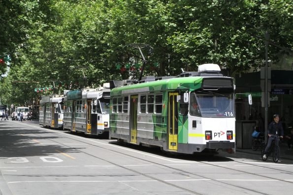 Z3.116 on route 16 leads a queue of northbound trams at Swanston and Bourke Street