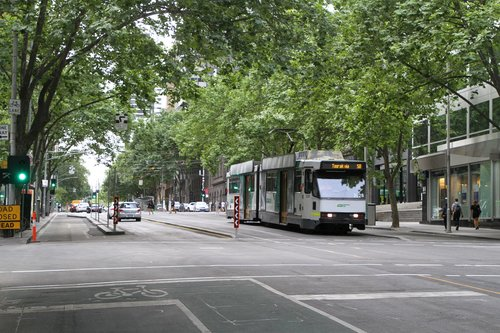 B2.2028 heads south along relaid track on route 58 at William and Little Collins Street