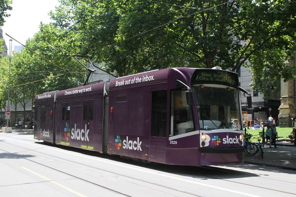 D1.3529 advertising 'Slack' heads south on route 6 at Swanston and Flinders Street