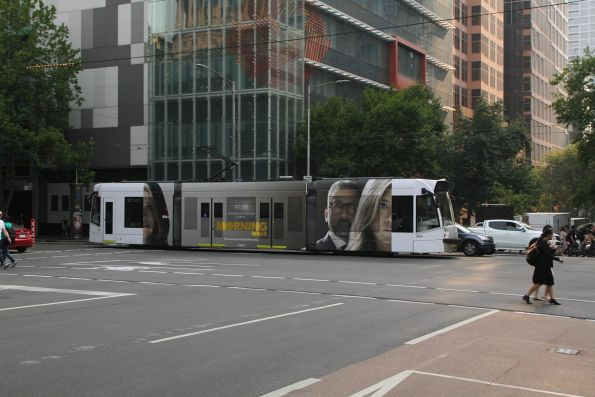 D1.3534 advertising 'Morning Wars' heads north on route 58 at William and Lonsdale Street