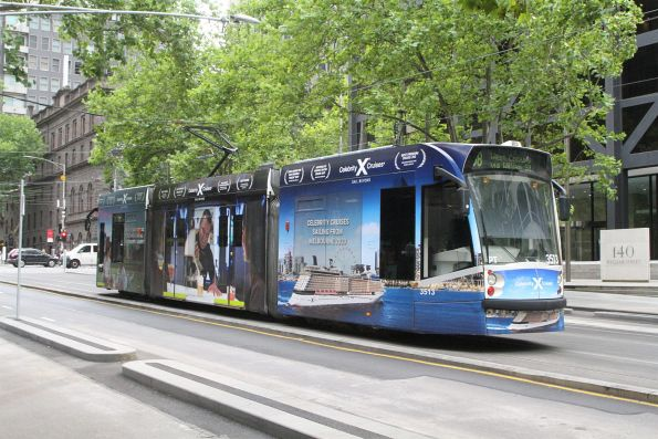 D1.3513 advertising 'Celebrity Cruises'  heads north on route 58 at William and Bourke Street