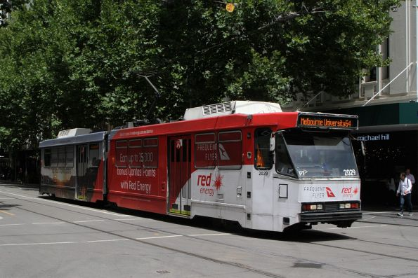 B2.2029 advertising 'Qantas and Red Energy' heads north on route 64 at Swanston and Bourke Street
