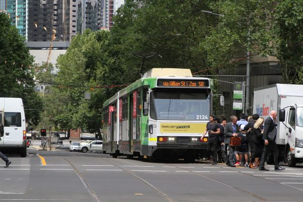 B2.2124 heads north on route 58 at an overcrowded safety zone tram stop William and Collins Street