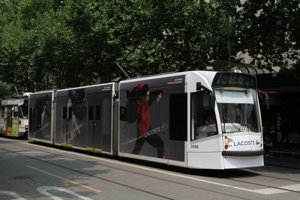 D1.3506 advertising 'Lacoste' heads north on route 5 at Swanston and Bourke Street