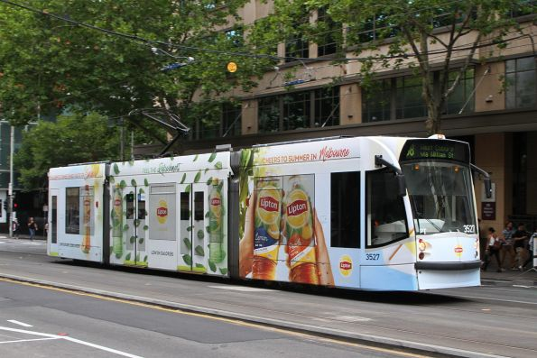 D1.3527 advertising 'Lipton Iced Tea' heads north on route 58 at William and Lonsdale Street