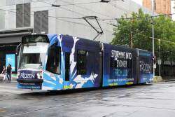 D1.3505 advertising 'Frozen' heads south on route 72 at Swanston and Collins Street