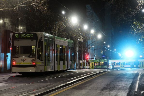 Flash of blue as an E class tram powers through the frog at William and Bourke Street