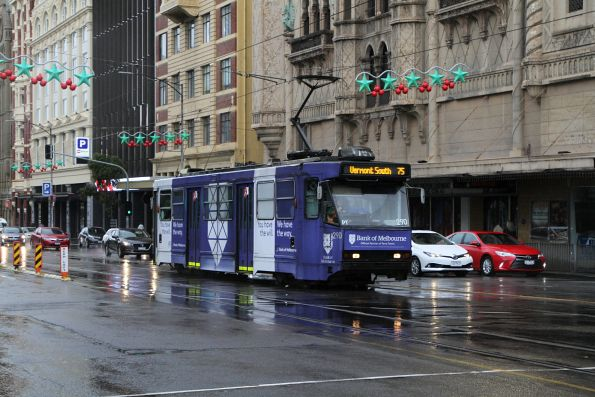 A2.290 advertising 'Bank of Melbourne' heads east on route 75 at Flinders and Russell Street