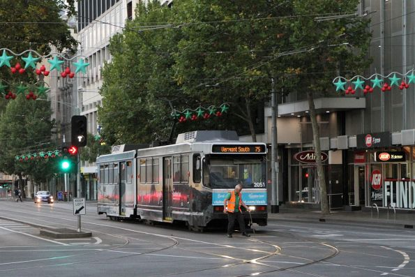 Driver of B2.2051 on route 75 throws the points at the corner of Flinders and Exhibition Street