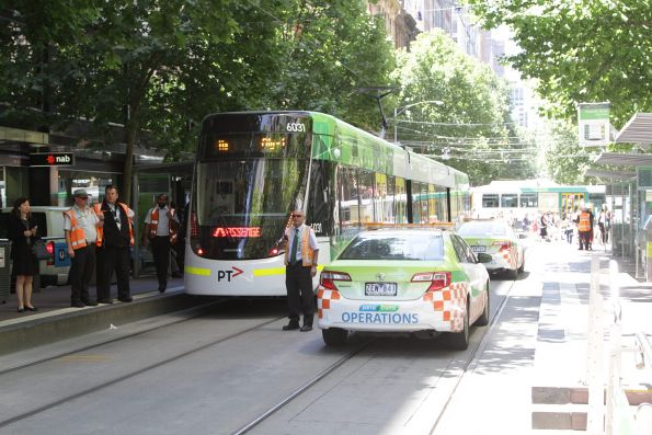 Yarra Trams operations staff work out whether to send E.6031 east on Collins Street towards the protest, or sent it back west