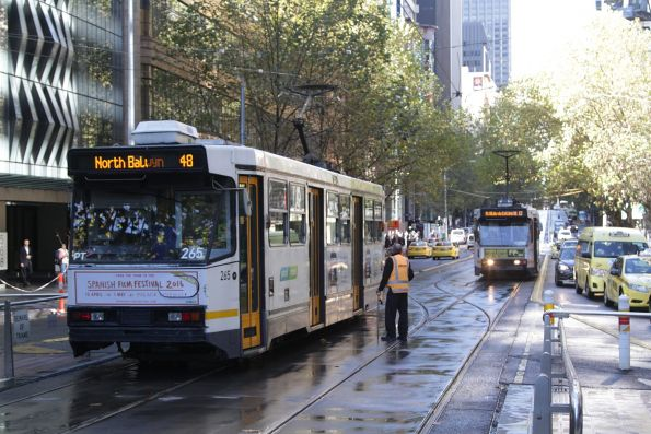 A2.265 heads east on route 48 along Collins Street at the King Street crossover, after trams have started running again