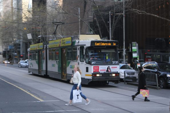 B2.2131 heads north on a diverted route 1 service at William and Bourke Street