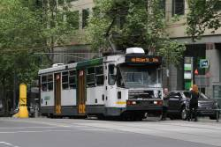 A1.254 heads north on a diverted route 64 service at William and Collins Street