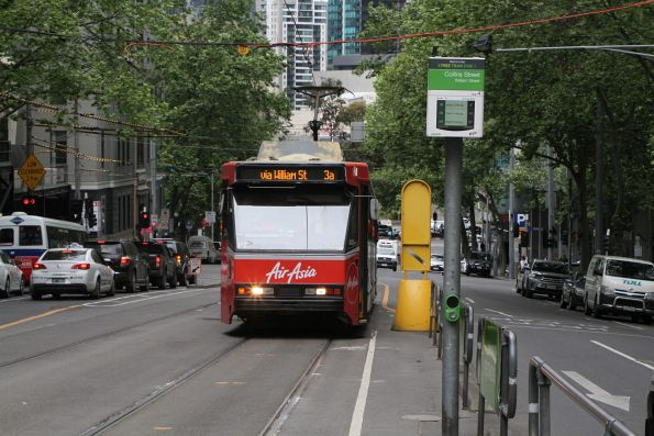 B2.2026 advertising 'Air Asia' heads north on a diverted route 3 service at William and Collins Street