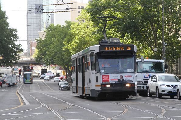 A2.286 heads north at Spencer and Collins Street on a route 12a service diverted via La Trobe Street