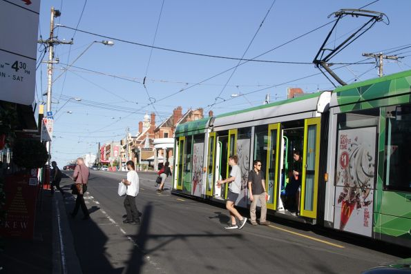 Route 48 trams leave a C class tram at Kew Junction