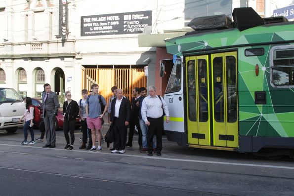 Route 72 passengers wait in the middle of Burke Road as they change to the train at Camberwell station