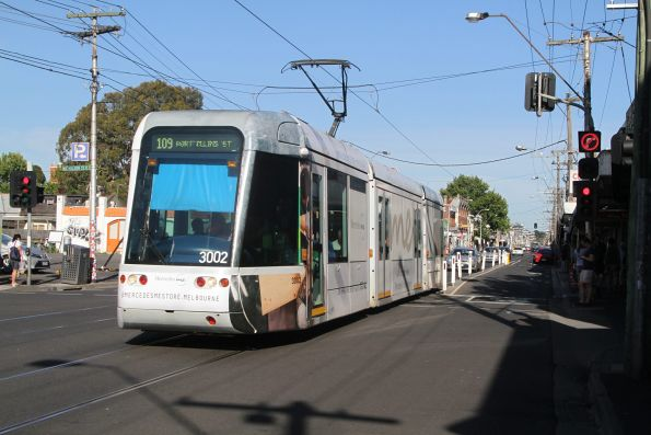 C.3002 advertising 'Mercedes Me' heads west on route 109 at Victoria and Nicholson Street