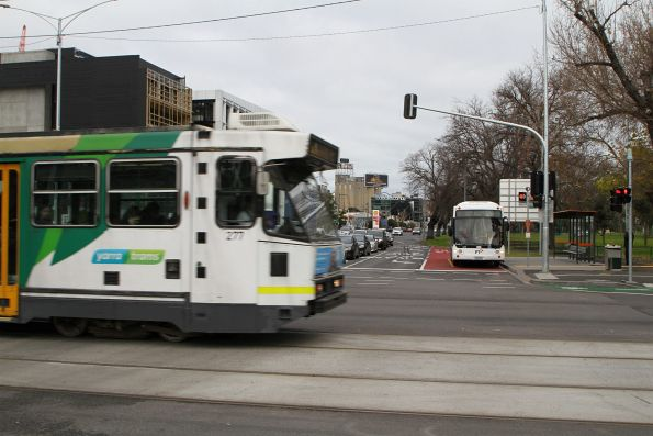 A2.277 on route 70 passes Transdev bus #520 0182AO northbound on route 246 at Punt Road and Swan Street