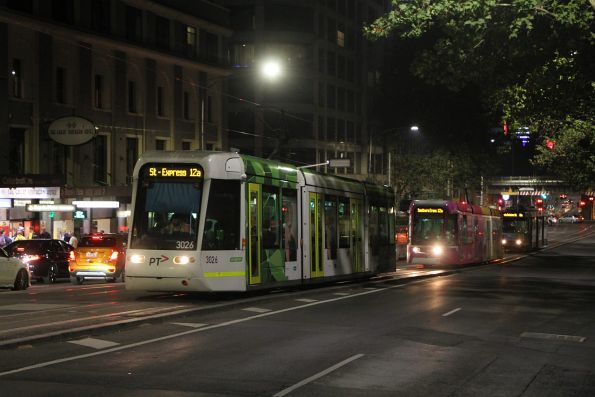 C.3026 at Spencer and Collins Street with a citybound Grand Prix shuttle