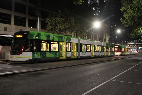 E2.6051 and classmate southbound at Spencer and Flinders Street southbound after running Grand Prix shuttles