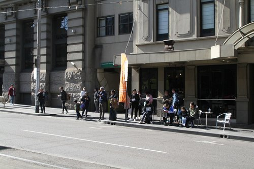 Passengers waiting for a southbound route 12 replacement bus at Spencer and Collins Street