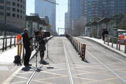 TV news crew reporting from the Spencer Street bridge