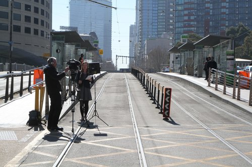 TV news crew reporting from the Spencer Street bridge