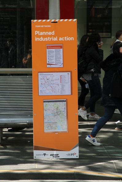 'Planned industrial action' signage at a Swanston Street tram stop