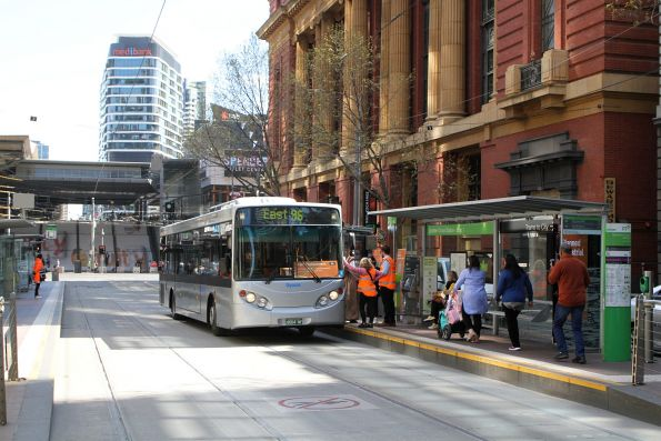 Dysons bus #1097 BS04NF on a route 96 tram replacement service at Bourke and Spencer Street
