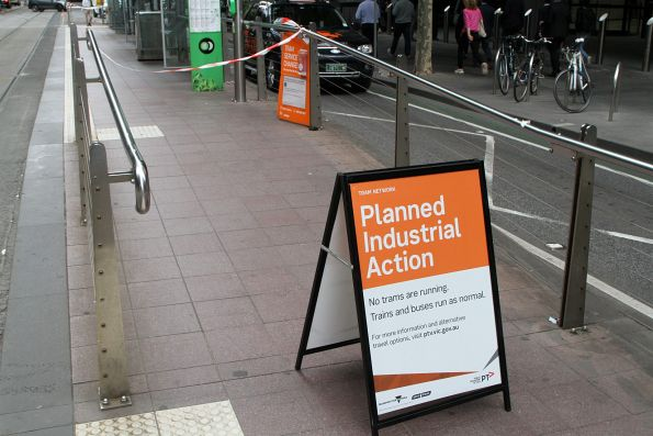 'Planned industrial action' signage at a Collins Street tram stop