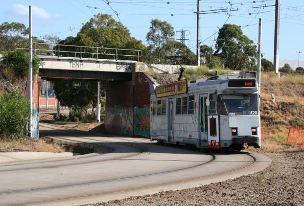 Z3.120 passes under the railway bridge at Royal Park