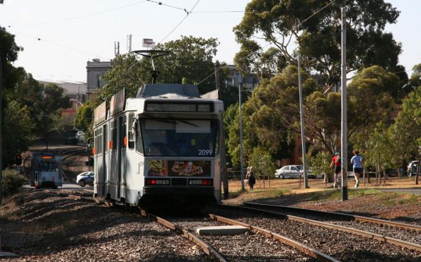 B2.2099 outbound waits for the tram ahead at Royal Park