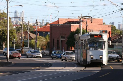 Z3.200 on route 55 heads outbound along Melville Road with the CBD skyline behind