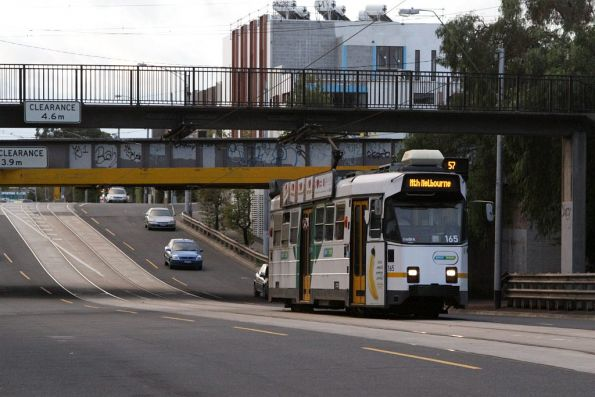 Z3.165 climbs out from under the Flemington Racecourse railway underpass with an inbound route 57 service