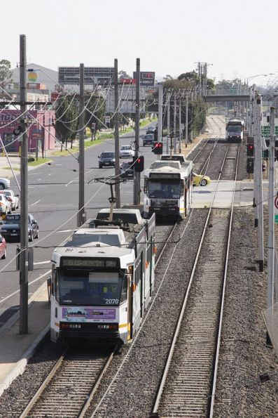 B2.2070 and B2.2022 on the reserved track on route 59, waiting at the traffic lights to Essendon Airport