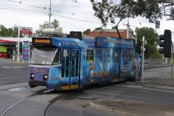 Z3.166 advertising 'Cavalia' turns from Abbotsford Street into Flemington Road with a route 57 service
