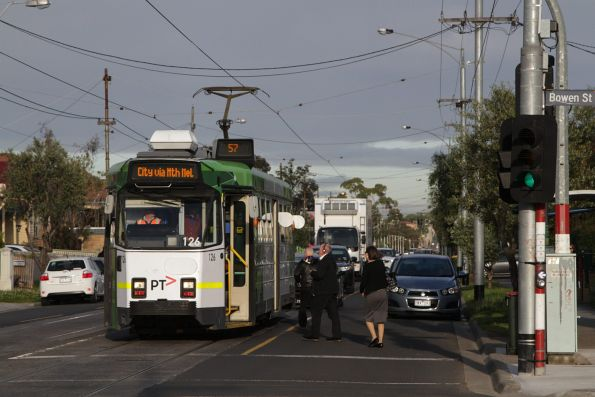 Passengers board a citybound route 57 service on Maribyrnong Road