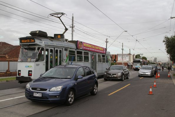 Z3.137 on route 55 waits for a citybound tram to shunt through the Daly Street crossover