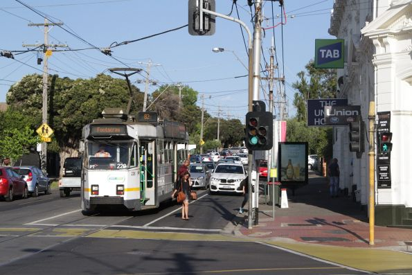 Z3.228 heads west at Maribyrnong and Union Road with a route 82 service