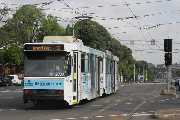 B2.2003 advertising 'Victoria University' heads west on route 59 at Flemington Road and Abbotsford Street
