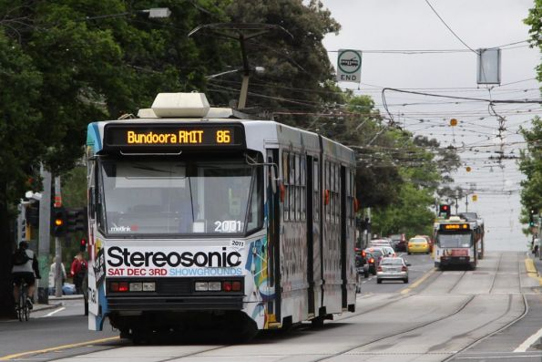 The two B1 class trams chase each other north along Nicholson Street