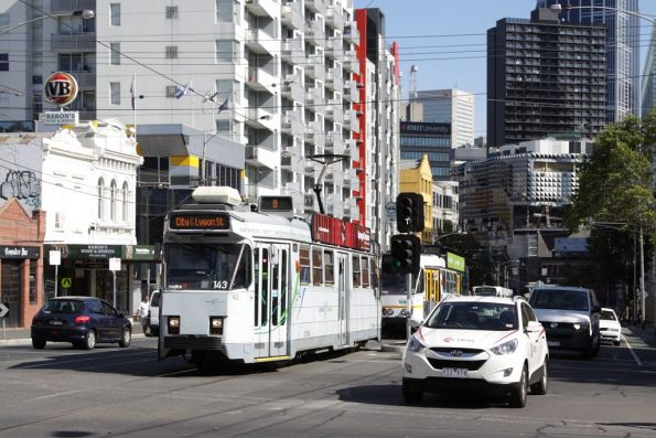 Z3.143 heads north on Swanston Street at Queensberry Street