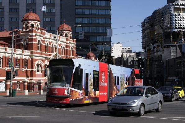 D1.3513 advertising Emirates passes the City Baths at Swanston and Victoria Streets