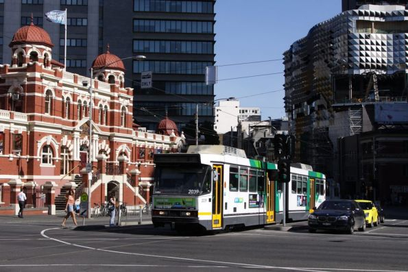 B2.2039 passes the City Baths at Swanston and Victoria Streets