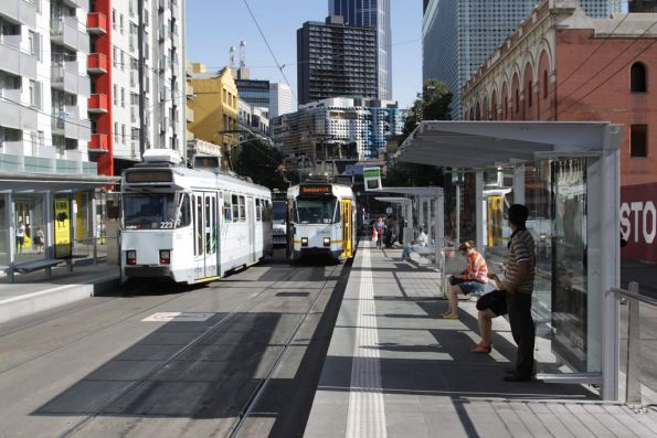 Trams pass at the new Queensberry Street platform stop