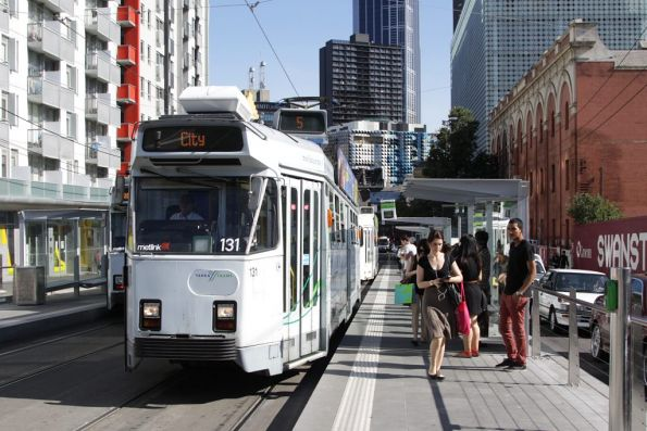 A pack of Z class trams descend on Swanston Street, turning passengers off at Queensberry Street so they can short shunt