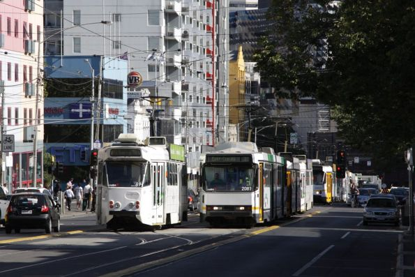 Z1.69 shunts at Queensberry Street, B2.2081 leading the growing queue of delayed trams on Swanston Street