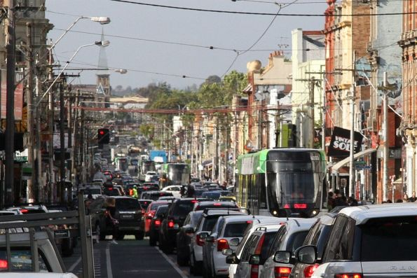 E class trams southbound on route 11 crawls along in traffic on Brunswick Street