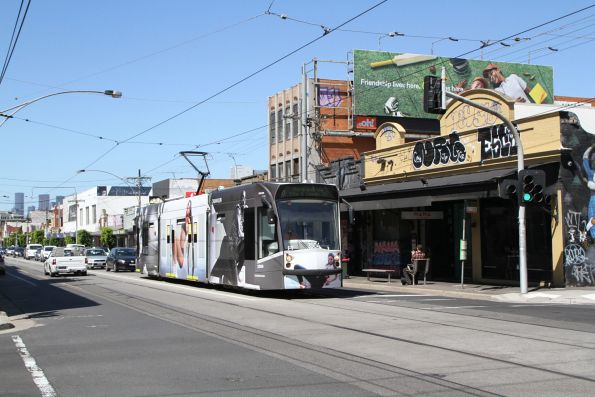 D1.3504 advertising 'Calvin Klein' heads north on route 6 at Lygon Street and Glenlyon Road